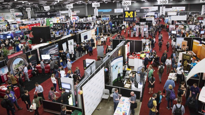 Visitors attend the 2015 Trade Show at the South by Southwest (SXSW) interactive, film and music conference in Austin