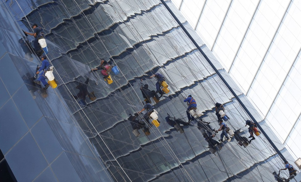 Window washers work at a building in downtown Buenos Aires