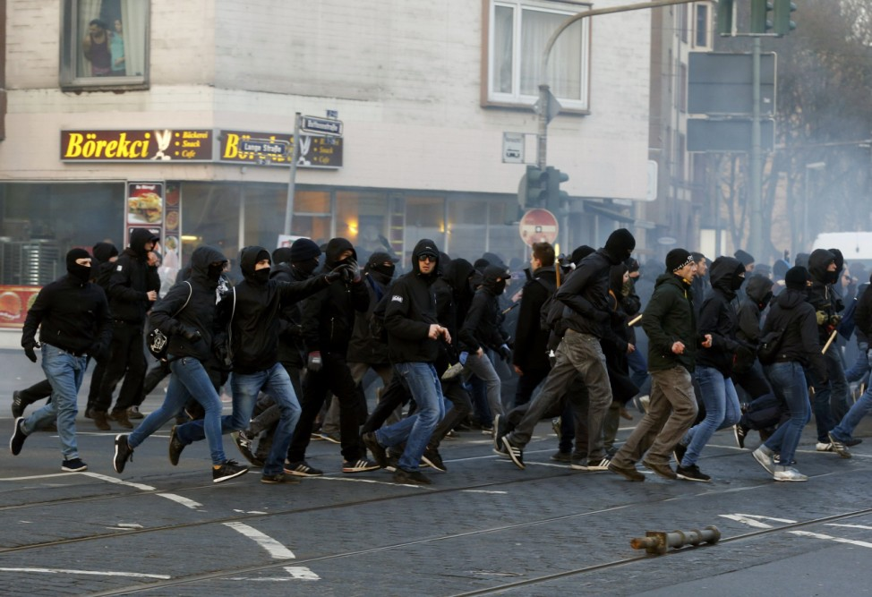 Anti-capitalist 'Blockupy' protesters run on a street near the ECB building before the official opening of its new headquarters in Frankfurt
