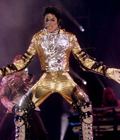 Pop superstar Michael Jackson grabs his crotch during his first of two concerts in Seoul October 11...; Jackson