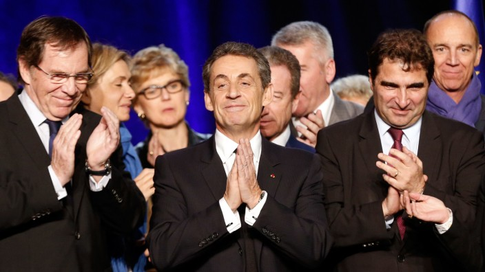- Current UMP right-wing opposition party President and former French President, Nicolas Sarkozy (C), flanked by French lawmaker and head of the UMP right-wing opposition party's parliamentary group,
