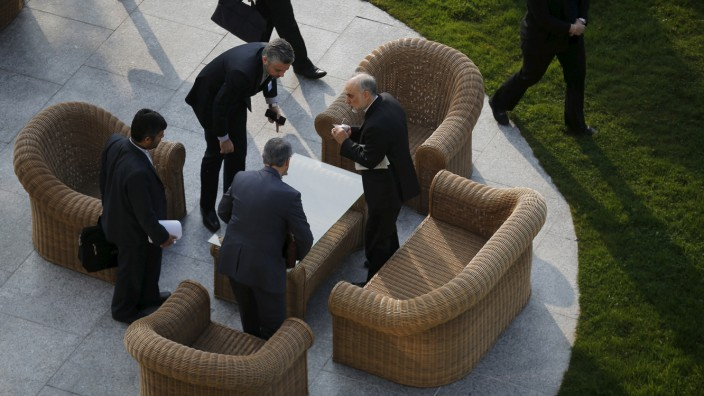 Head of the Atomic Energy Organization of Iran Salehi talks with his team before a negotiating session with the U.S. and the European Union over Iran's nuclear programme in Lausanne