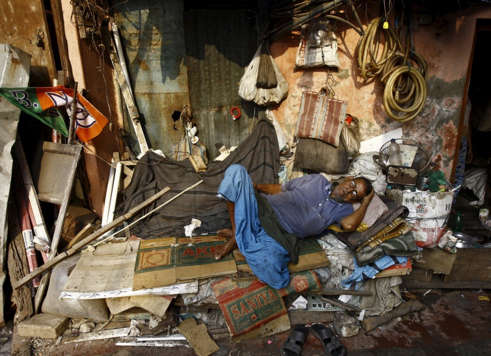 A labourer takes a nap in a wholesale fruit market area in Kolkata