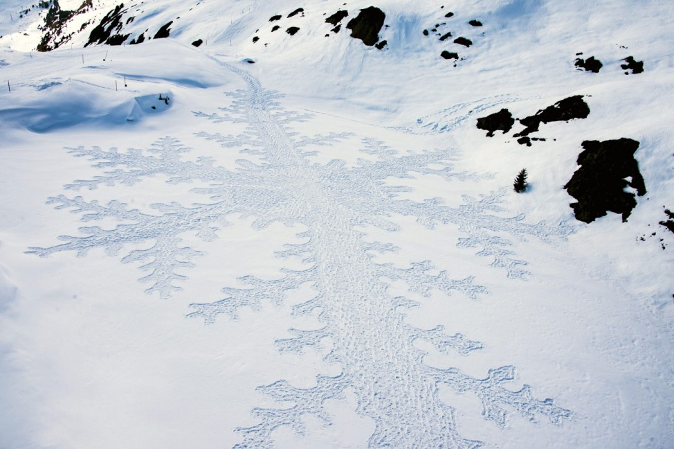 British artist Simon Beck creates snow art