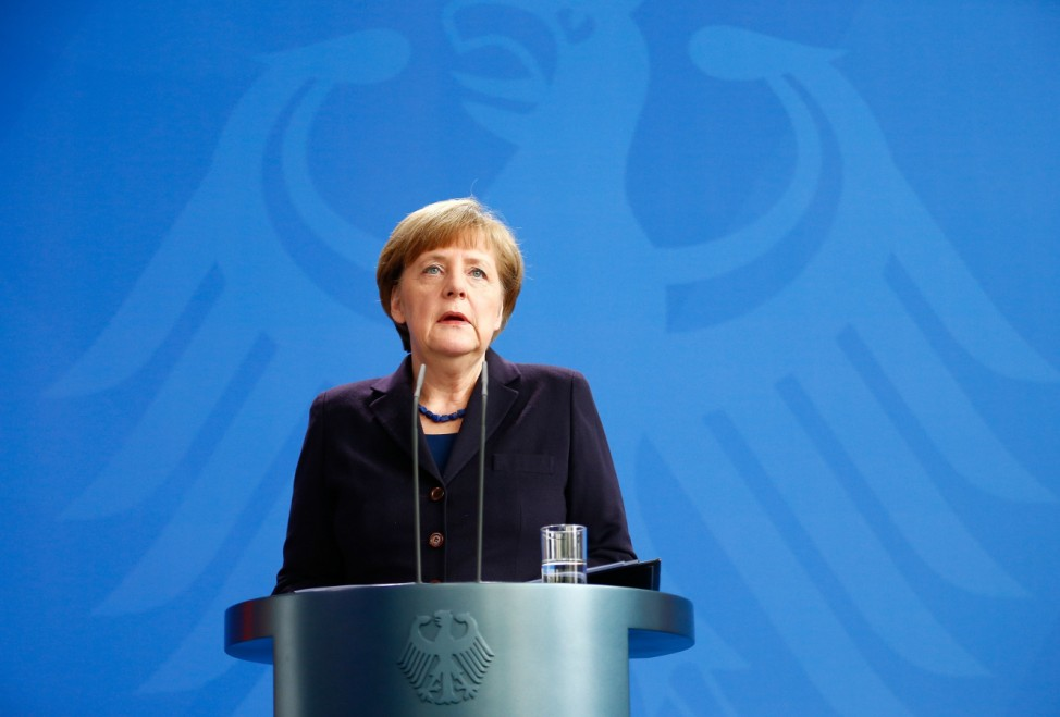 German Chancellor Angela Merkel reacts as she makes a statement in Berlin