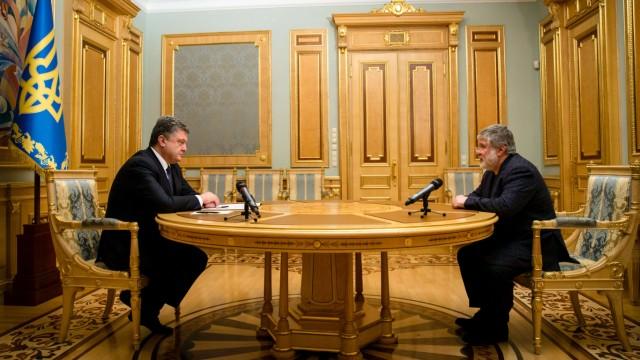 Ukraine: Als Gouverneur entlassen, aber die Kontrolle über Energiegeschäfte will Ihor Kolomojskij (r.) sich von Präsident Petro Poroschenko nicht nehmen lassen.