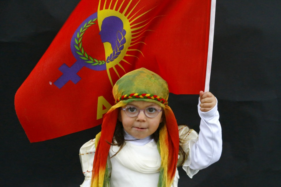 A Kurdish girl poses for a picture as she arrives for a gathering celebrating Newroz in Diyarbakir