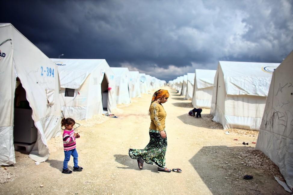 Syrian Refugees Seek Shelter In Turkish Camps