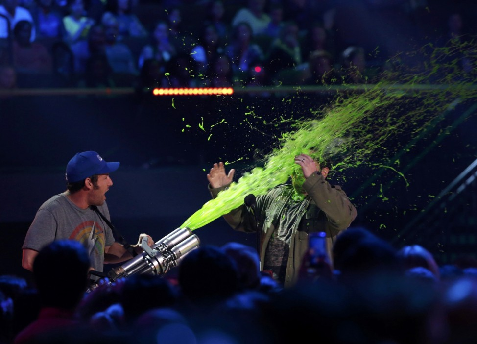Sandler slimes fellow actor Gad on stage at the 2015 Kids' Choice Awards in Los Angeles