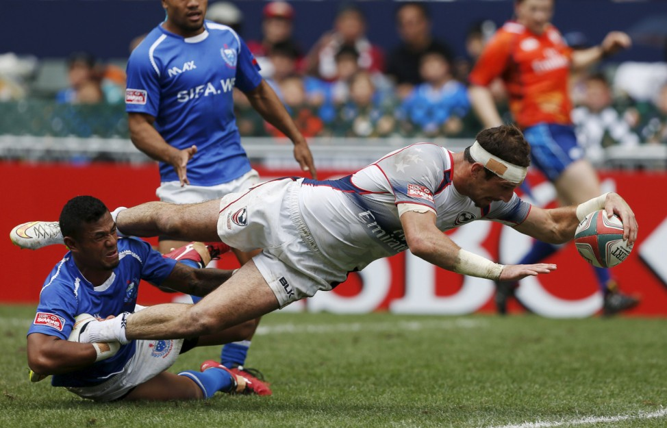 United States' Test scores a try as he is tackled by Samoa's Iosefo during their quarter-final match at Hong Kong Sevens rugby tournament