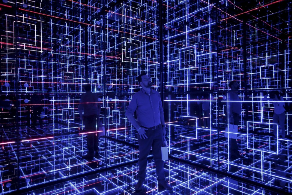 Man looks at an exhibition called 'Oh! Future Sensation' as part of Saint-Gobain's 350th anniversary celebrations, in Sao Paulo