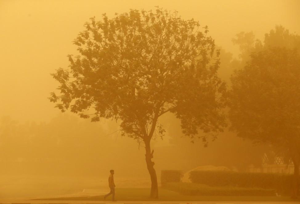 A man walks during a sand storm in Dubai