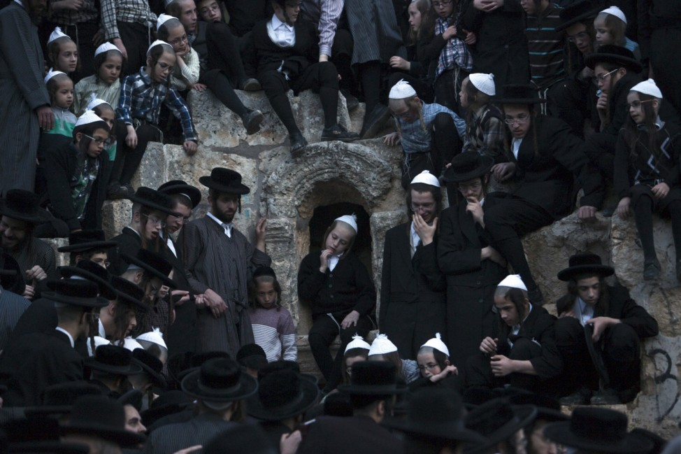Ultra-Orthodox Jews take part in the 'Mayim Shelanu' ceremony to collect water from a natural spring, near Jerusalem