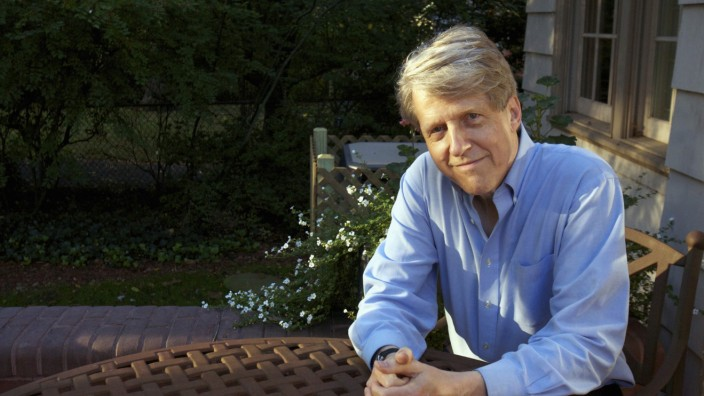 Shiller, one of three American scientists who won the 2013 economics Nobel prize, poses at his home in New Haven, Connecticut