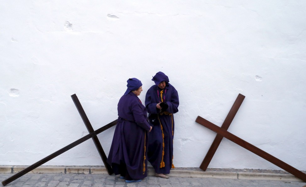 Penitents take part in the 'El Nazareno' during Holy Week in Castro del Rio
