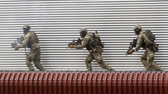 Members of German army Bundeswehr Special Forces Command enter a house while demonstrating their skills at training in Claw near Stuttgart