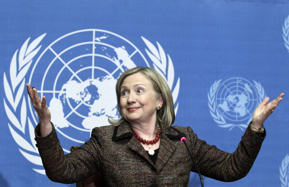 US Secretary of State Clinton gestures during a news conference after her speech at the United Nations Human Rights Council in Geneva