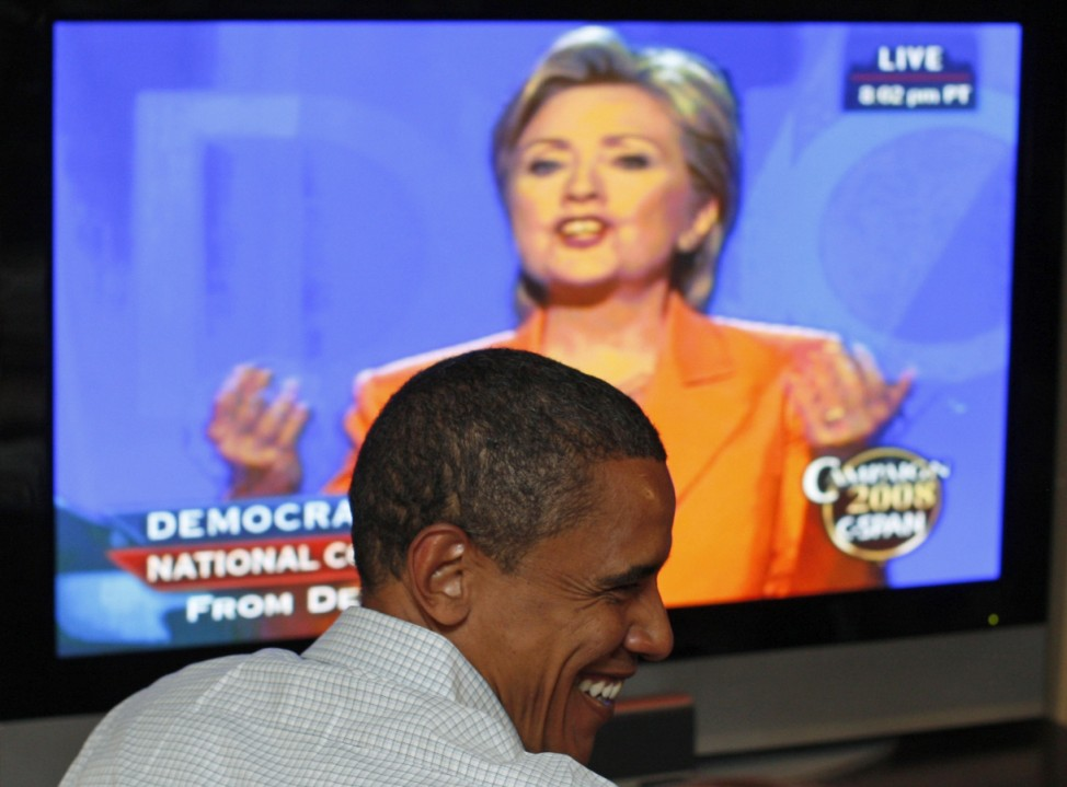 US Democratic presidential candidate Senator Barack Obama (D-IL) watches Senator Hillary Clinton deliver her speech at the 2008 Democratic National Convention in Billings, Montana