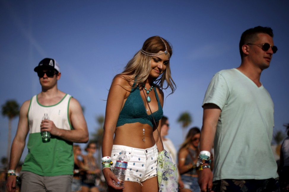 People walk through the Coachella Valley Music and Arts Festival in Indio