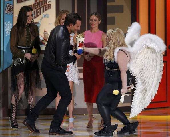 Actress Wilson presents the award for Best Male Performance to Cooper for 'American Sniper' as Wilson's 'Pitch Perfect 2' co-stars  watch at the 2015 MTV Movie Awards in Los Angeles