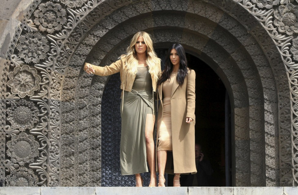 U.S. television personality Kim Kardashian and her sister Khloe Kardashian walk out of the Mother Armenia monument in Yerevan