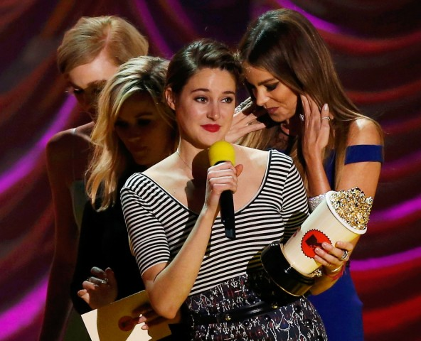 Actress Shailene Woodley accepts the award for Best Kiss for 'The Fault in Our Stars' at the 2015 MTV Movie Awards in Los Angeles