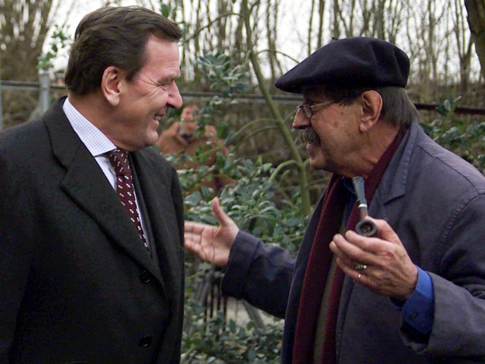 Grass, German writer and Nobel literature laureate, welcomes German Chancellor Schroeder at his home, outside the northern German village Behlendorf