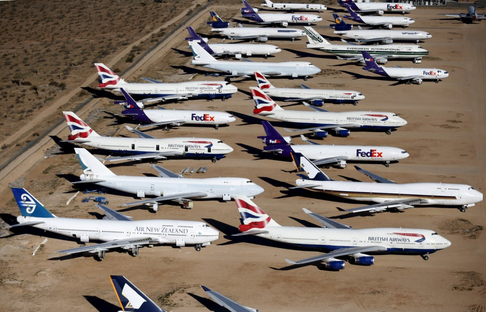 Old airplanes, including British Airways and Air New Zealand Boeing 747-400s, are stored in the desert in Victorville
