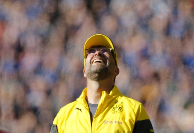 Borussia Dortmund's coach Klopp reacts following a goal from his team during their German first division Bundesliga soccer match against SC Paderborn in Dortmund