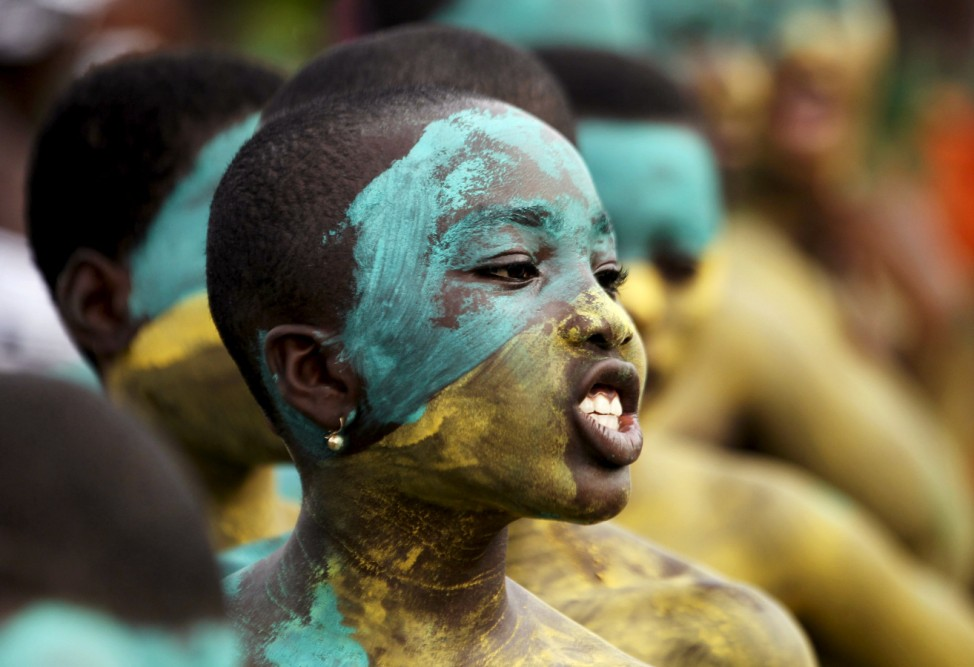 Youth with a painted face sings in a parade during the Popo (Mask) Carnival of Bonoua, in the east of Abidjan