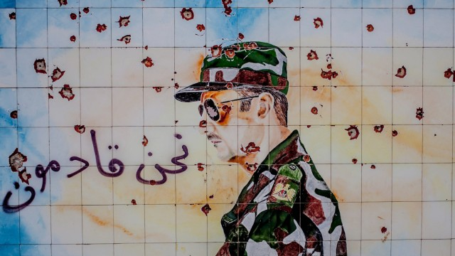 Almost all military bases and schools across Syria holds wall graffitis of the country s familyhood