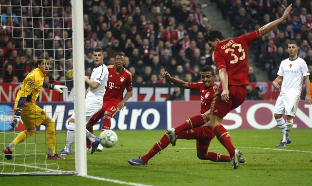 Bayern Munich's Gomez shoots and scores the third goal for the team during their Champions League round-of-16 second leg soccer match against FC Basel in Munich