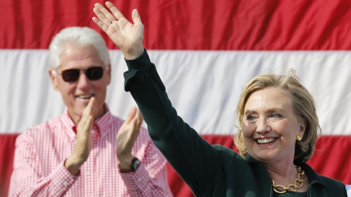Former U.S. Secretary of State Hillary Clinton is applauded by her husband former U.S. President Bill Clinton at the 37th Harkin Steak Fry in Indianola