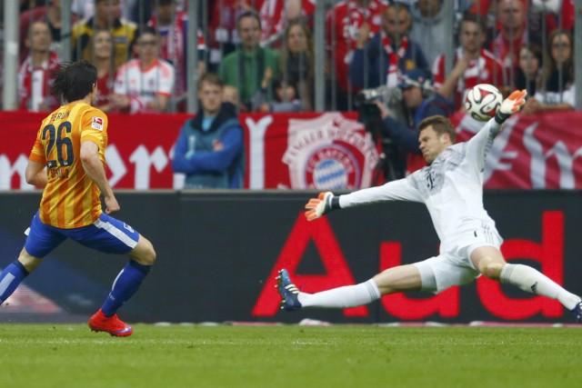 Hertha Berlin's Nico Schulz fails to score past Bayern Munich's Neuer during Bundesliga first division soccer match in Munich