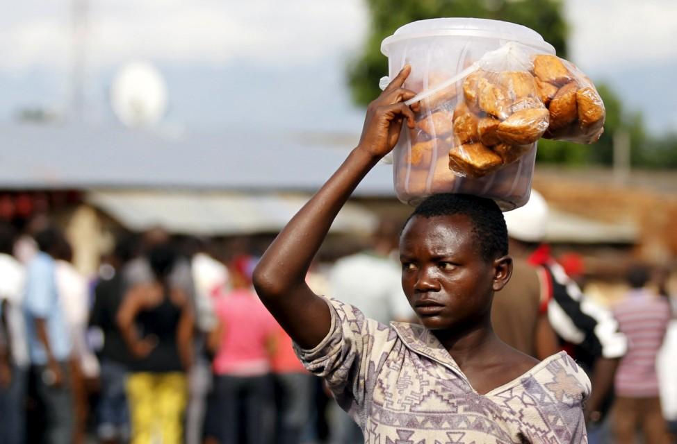 Vendor sells doughnuts during protests in Burundi's capital Bujumbura