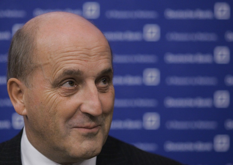 Deutsche Bank board member Heydebreck smiles during a news conference in Moscow