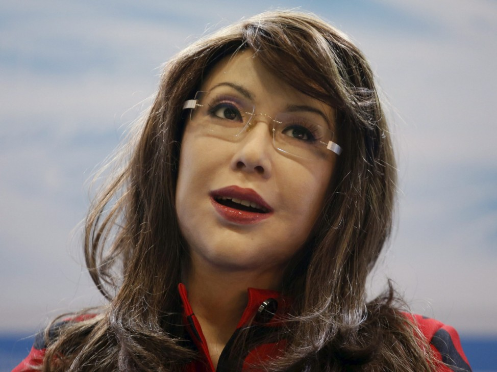 A humanoid robot named 'Yangyang' shows a facial expression during its demonstration at the Global Mobile Internet Conference (GMIC) 2015 in Beijing