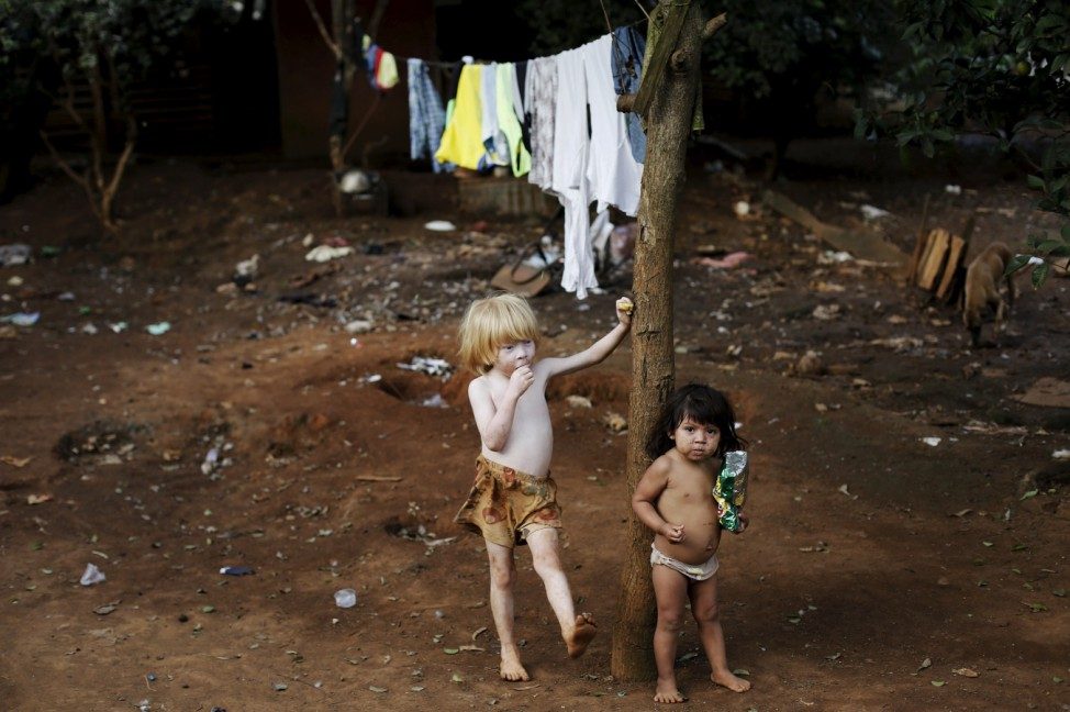 Guarani Indian boys stand in the village of Pyau, in Sao Paulo