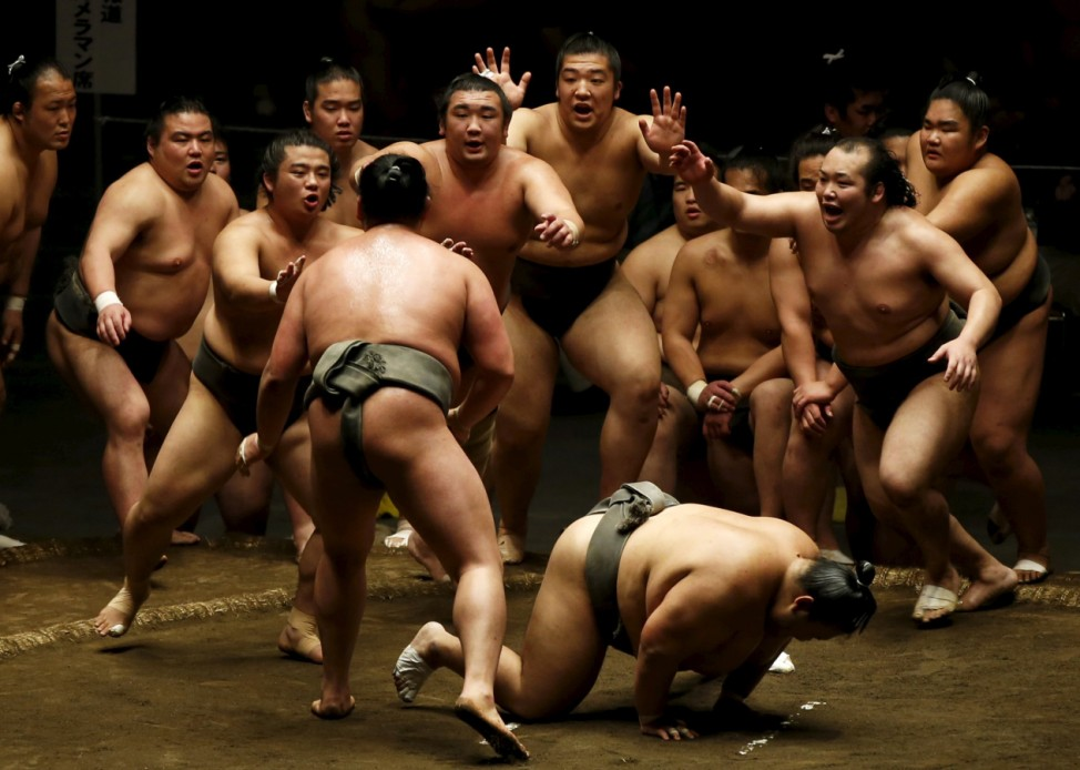 Sumo wrestlers of Nishonoseki clan appeal to the winner of a training bout for the next opponent during a joint training session ahead of the May Grand Sumo Tournament in Tokyo