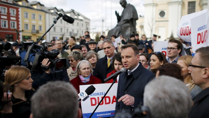 Duda, presidential candidate of opposition party Law and Justice (PiS), addresses his supporters during an election campaign rally in Mlawa