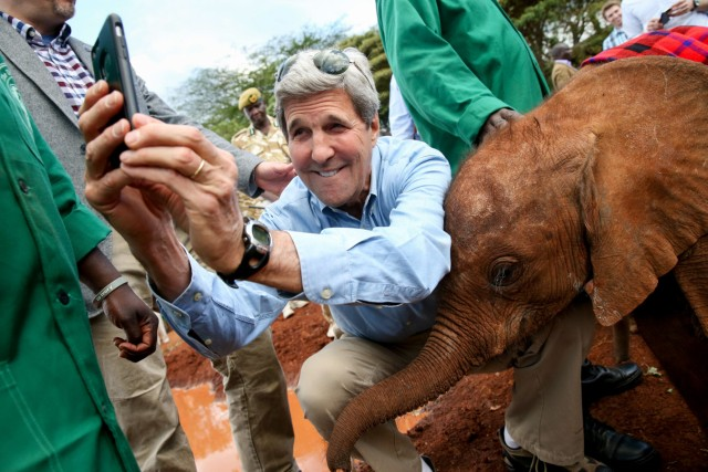 S Secretary of State John Kerry takes a selfie with a baby elephant while touring the Sheldrick Center Elephant Orphanage at the Nairobi National Park