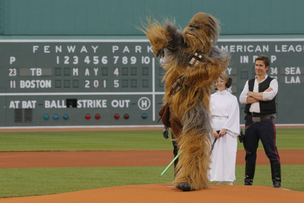 People dressed as Star Wars characters Chewbacca, Princess Leia and Han Solo throw out the ceremonial first pitch before the MLB baseball game between the Tampa Bay Rays and the Boston Red Sox at Fenway Park in Boston
