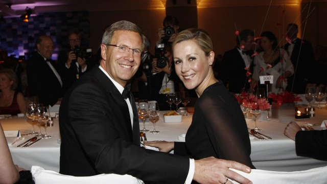 (FILE) Former German President Wulff and Wife Bettina Seperate Bundespresseball 2011