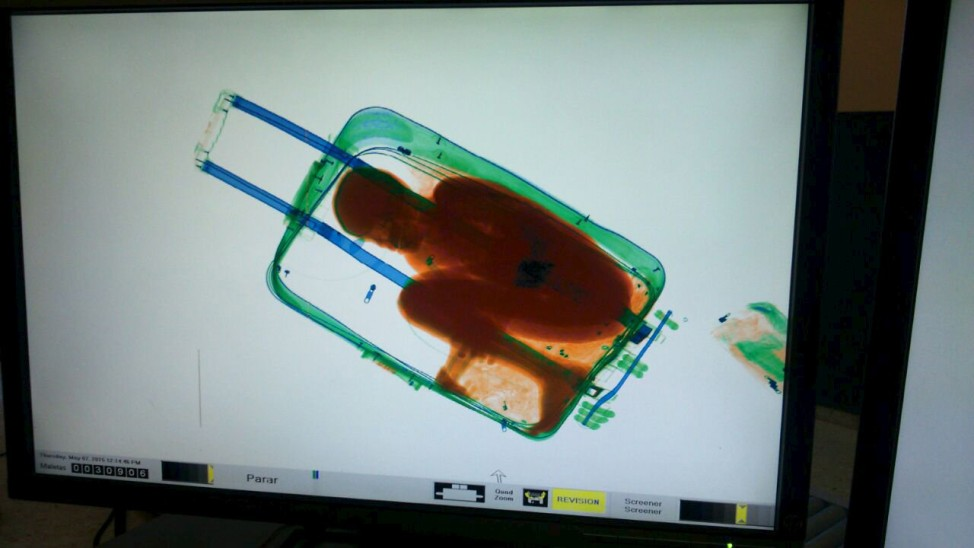 Handout photo of the figure of a boy inside a suitcase is seen on a scanner at the border between Spain's north african enclave Ceuta and Morocco