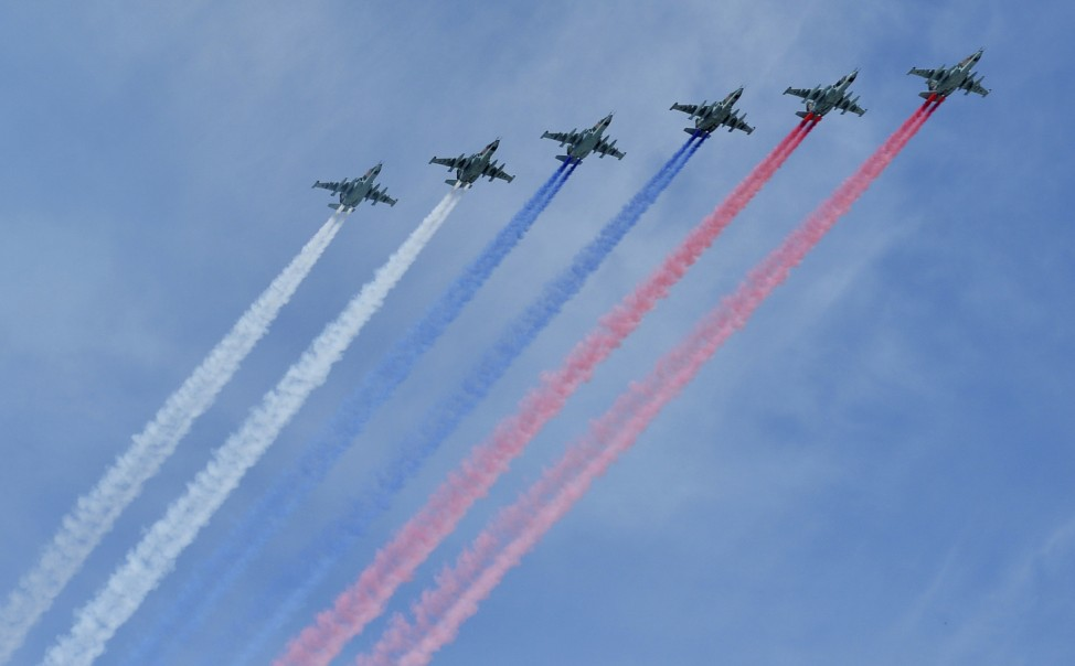 Russian Sukhoi Su-25 Frogfoot ground-attack planes fly in formation over the Red Square during the Victory Day parade in Moscow