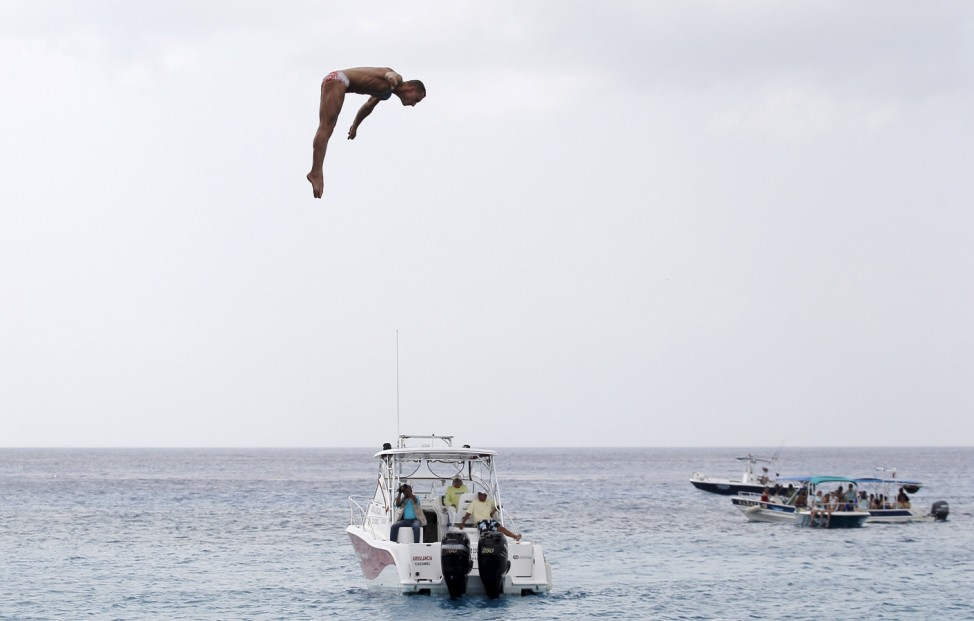 Kutsenko from Ukraine performs a dive during the FINA High Diving World Cup in Cozumel