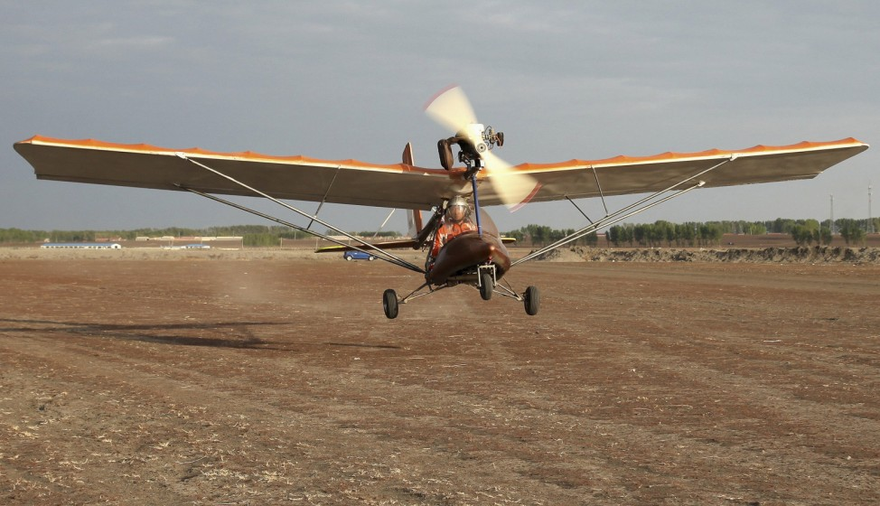 Yang, a 45-year-old manager of a construction material company, flies his homemade plane during a test run in Changchun