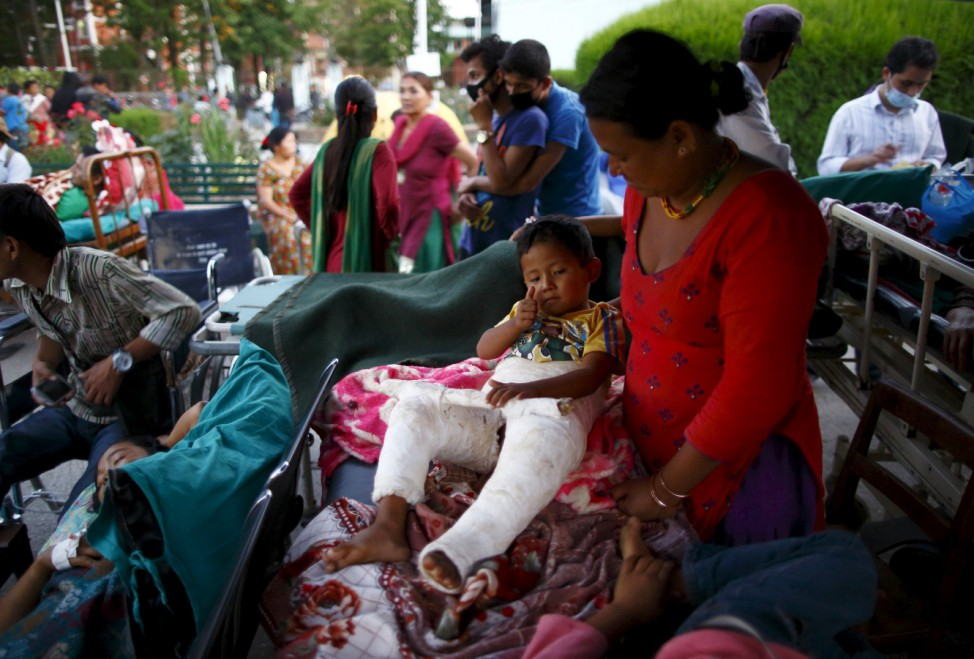 Earthquake victims are kept on the open ground for treatment after the earthquake, in Kathmandu