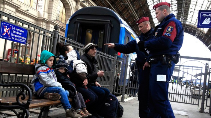 Hungarian policemen check the documents of Kosovars in Keleti (Eastern) railway station in Budapest