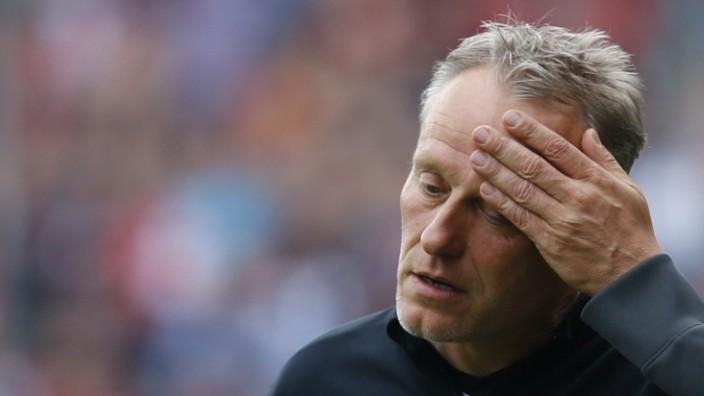 Freiburg's coach Streich reacts during their German Bundesliga first division soccer match against Bayern Munich in Freiburg